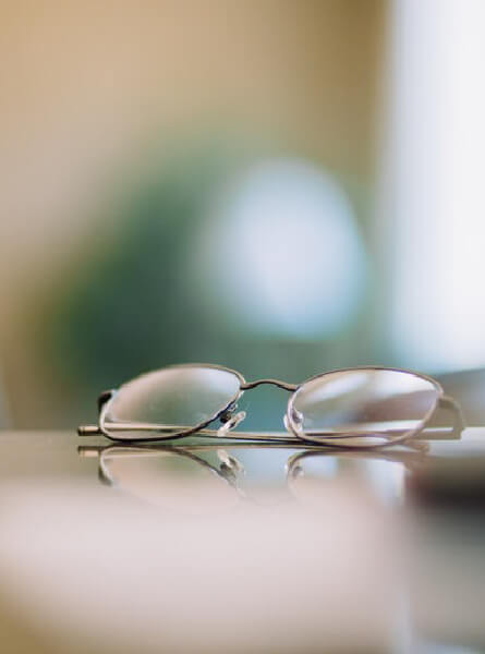 Eye glasses on a table