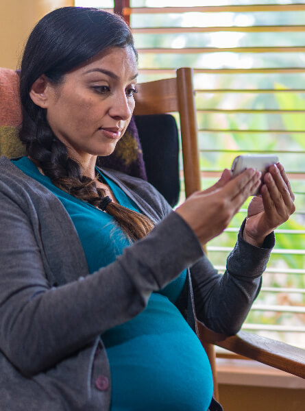 Pregnant woman using phone