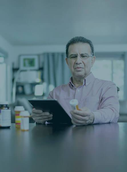Man looking up medication online
