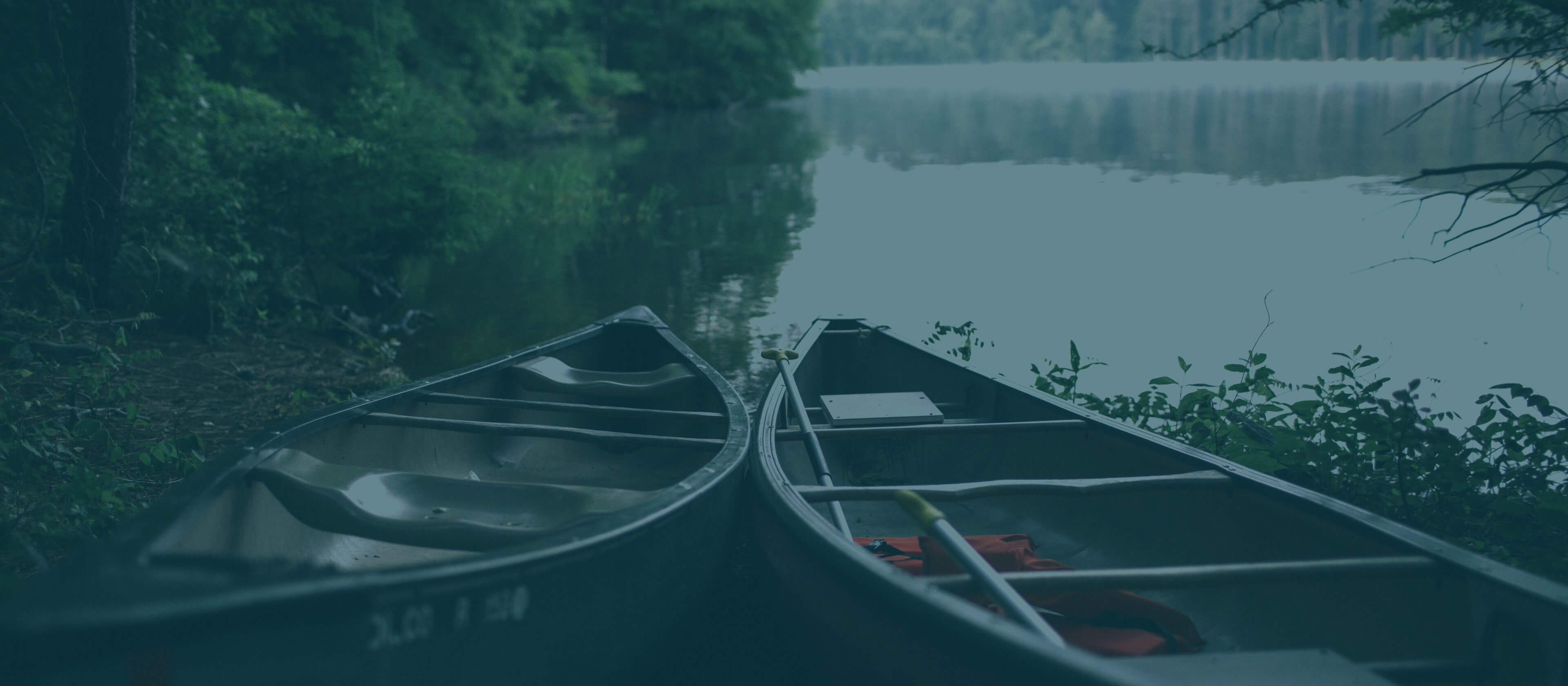Two canoes by a lake